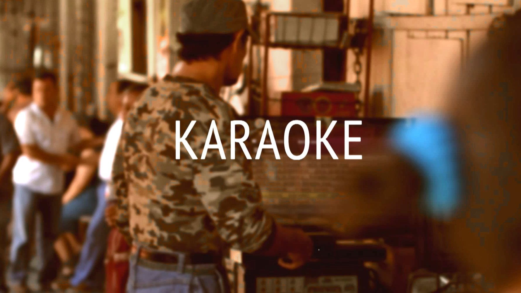 Juan sing Karaoke in Berlin, El Salvador.