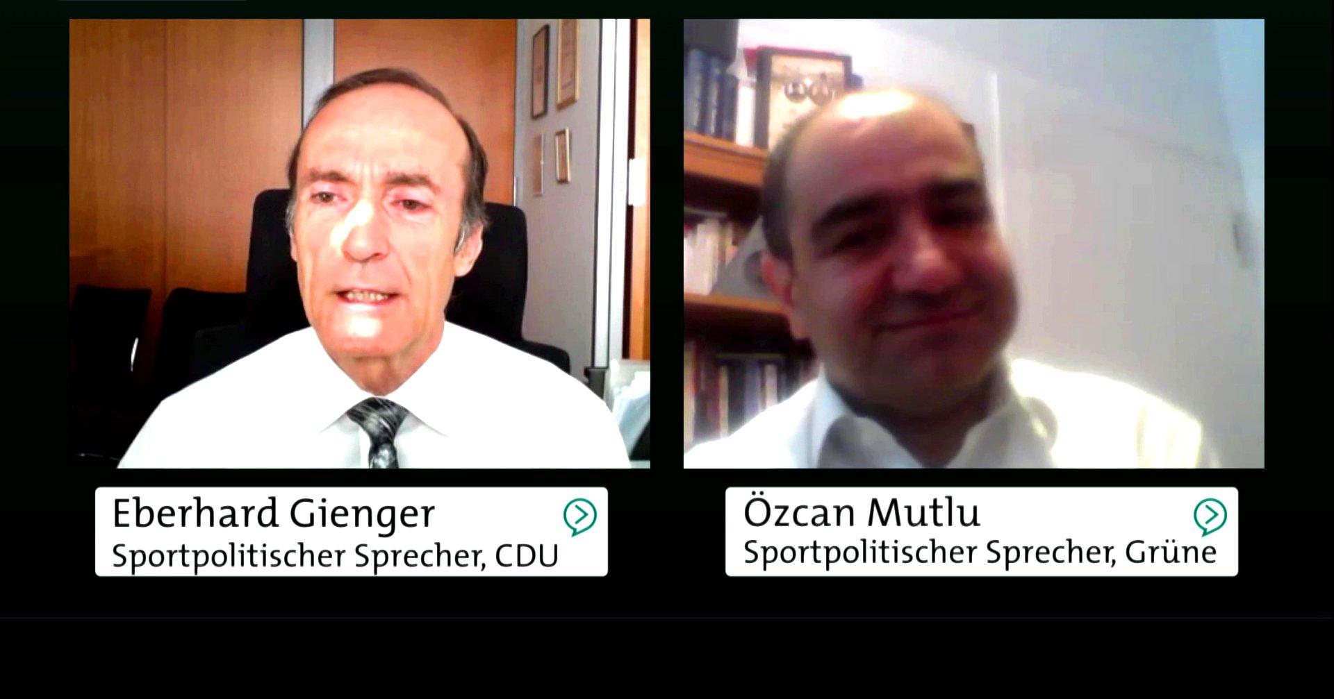 Streitgespräch zwischen Özcan Mutlu (Sprecher für Sport- und Bildungspolitik der Grünen) und Eberhard Gienger (sportpolitischer Sprecher, CDU).